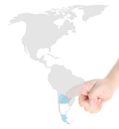 Finger touch on Argentina map flag photo