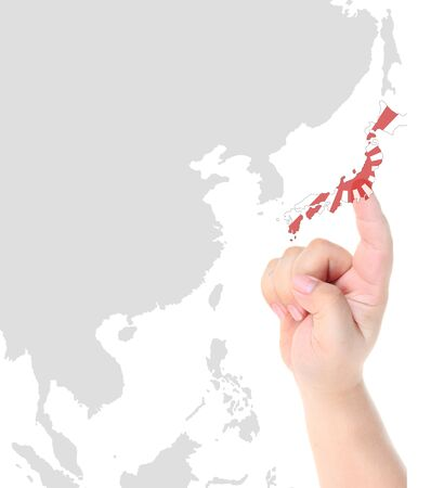 Finger touch on Japan map flag photo