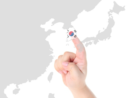 Finger touch on South Korea map flag Stock Photo - 10759989