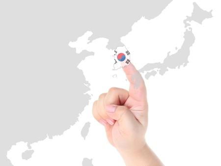 Finger touch on South Korea map flag