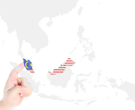 Finger touch on Malaysia map flag Stock Photo - 10759983