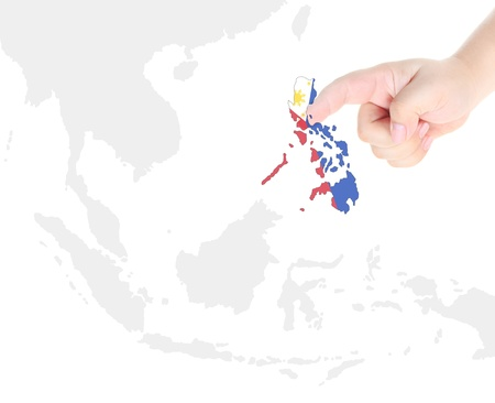 Finger touch on Philippine map flag photo
