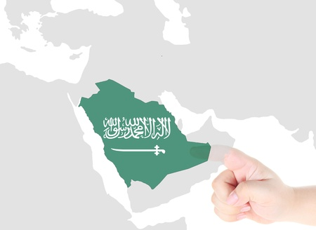 Finger touch on Saudi Arabia map flag photo