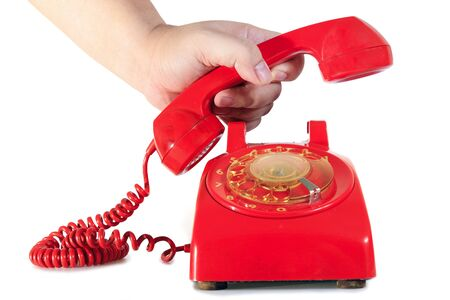 hand picking retro dial style red house telephone  photo