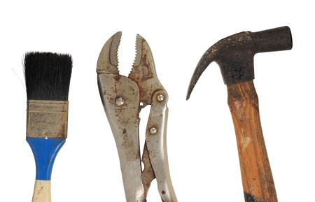 Grunge dirty old home tools hammer, brush and monkey wrench isolated on white background photo