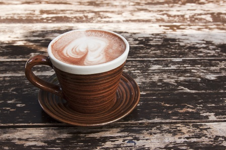 warm drink: brown cup of hot chocolate with creamy milk Stock Photo