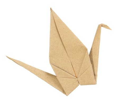 Origami bird made from brown recycle paper isolated on white background photo