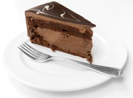 Dark chocolate layer cake on white plate