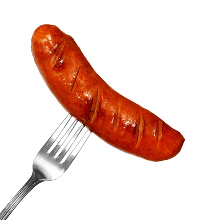 Unhealthy grilled barbecue sausage isolated on white background photo