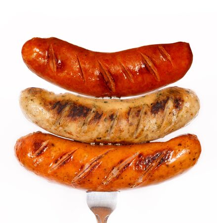 veal sausage: Unhealthy grilled barbecue sausage isolated on white background