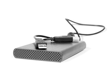 gigabytes: Metallic portable gigabytes harddrive isolated on white background