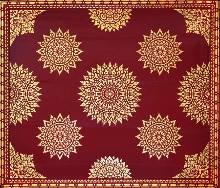 Golden on red thai painting wallpaper, Buddha temple wall and ceiling decoration photo