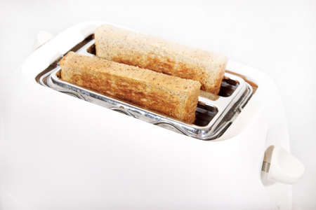 White toaster and crispy wholewheat bread photo