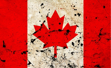 Canada flag painted on grunge old cement wall photo