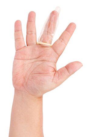 Condom on finger isolated on white background  Stock Photo - 13495381