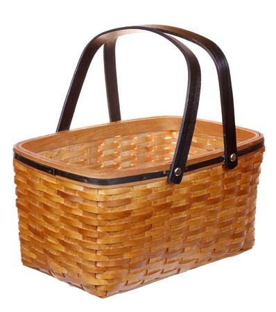 Yellow wicker basket isolated on white background  photo