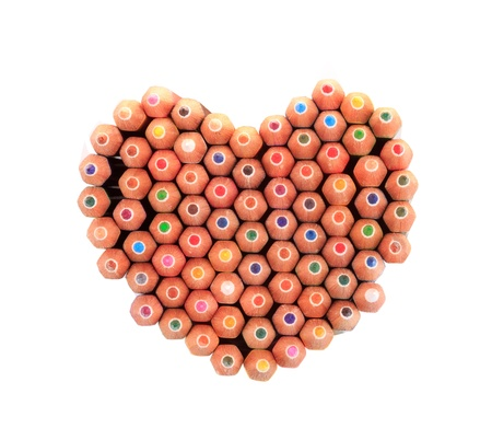 Color pencils arrange in heart shape  isolated on white background close up photo