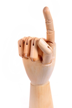wood figurine: Wooden dummy hand point sign isolated white background Stock Photo