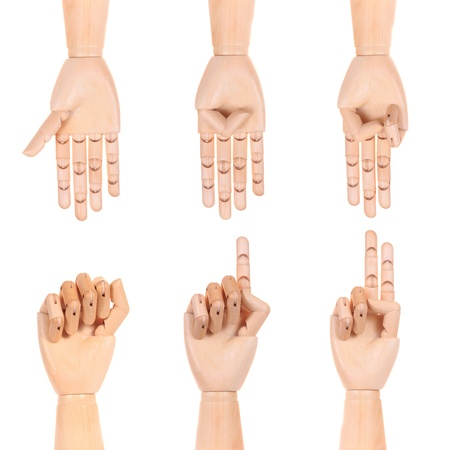 Wooden dummy hand sign of number zero to file isolated white background photo