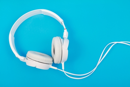 Modern white headphone isolated on blue background  Stock Photo