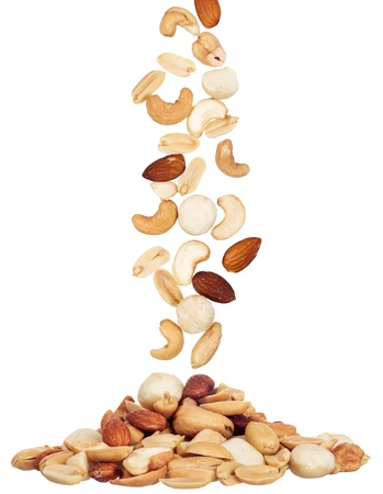 pile of macadamia, almond and cashew nuts isolated on white background  photo