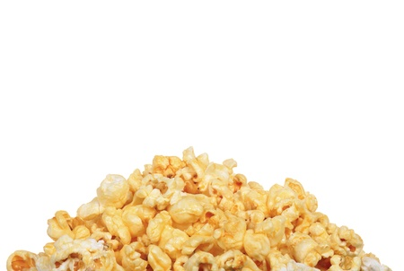 buttery: Pile of buttery popcorn isolated on white background