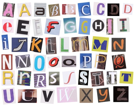 English alphabet cut from magazine isolated on white background  photo