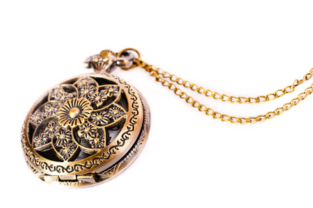 Vintage gold copper pocket watch isolated on white