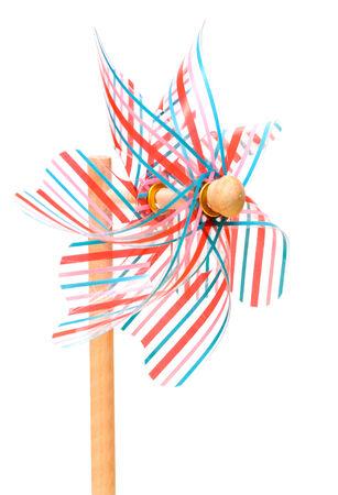 pinwheels: Colorful plastic pin wheel toy on white background