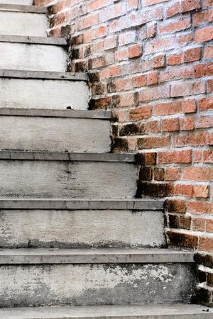 Vintage stair and orange brick wall photo
