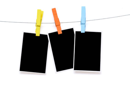 Colorful clothespin hang blank photo paper on white background photo