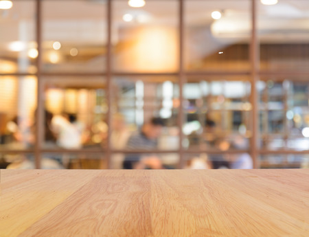 cafe: Wooden table and blur restaurant background
