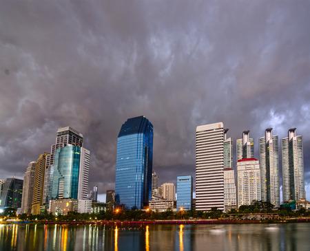 benjakitti: Bangkok, THAILAND, 11 October 2014, Night scene reflection of downtown city from lake inside Benjakitti park.
