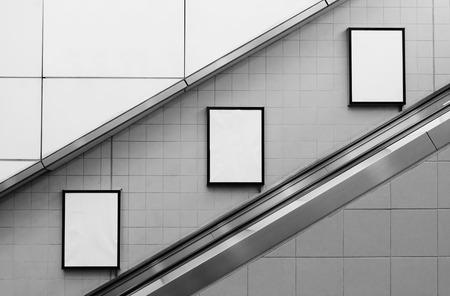 bill board ads at escalator side 스톡 콘텐츠