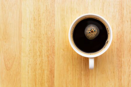 espesso: Black espesso coffee on wooden table Stock Photo