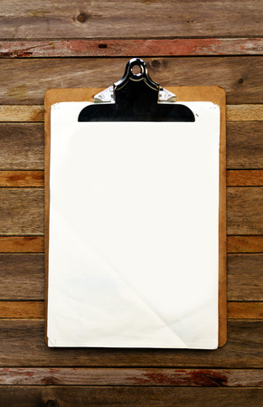 pad: Blank clip on menu on wooden background