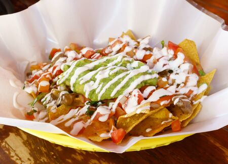 nacho: Beef Nacho with cheeses, salsa, guacamole and sour cream