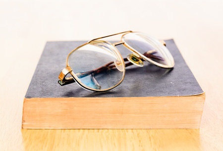 Eye Glasses On An Accounting Book With Yellow Pencil And ...