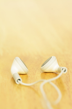 ear phone: White ear phone on wooden table