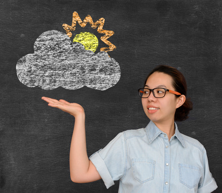 partial: Asian woman show weather forecast partial cloud sign on chalkboard