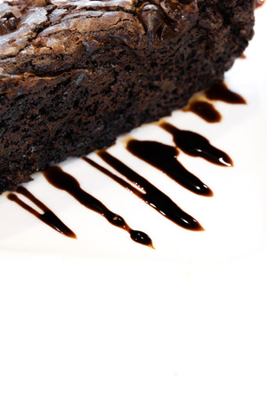 fudge: Chocolate brownie with hot fudge Stock Photo