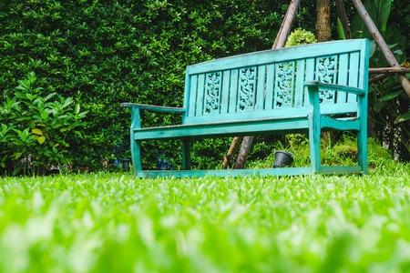 low angle: vintage bench in grass garden from low angle shot Stock Photo