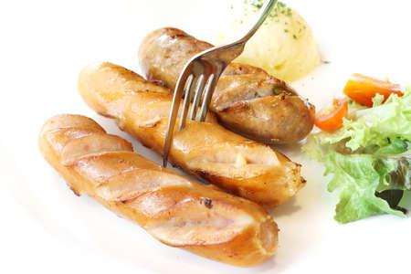german sausage: Grilled German sausage with mash potato