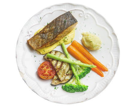 sauces: Salmon steak and roasted vegetables with lemon cream sauces