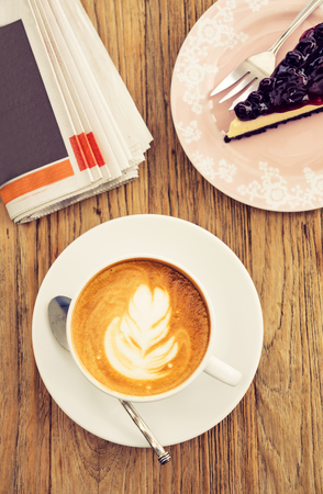 blue berry: Morning hot coffee latte with blue berry cheese cake leisure lifestyle on wooden table