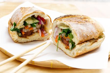 Vietnam style french baguette bread pork bun Banh Mi Stock Photo