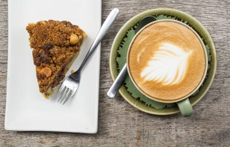 Apple crumble pie with big coffee latte cup