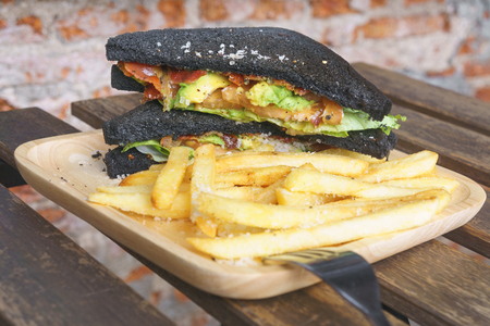 sanwich: charcoal bread with guacamole bacon and tomato sanwich Stock Photo