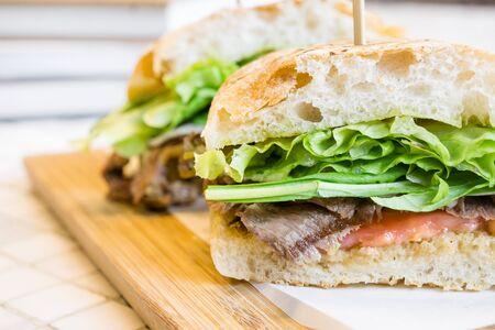 sanwich: homemade roast beef french bread sandwich Stock Photo