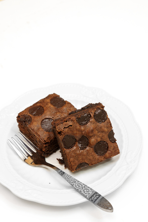 Chocolate brownie isolated on white background Imagens